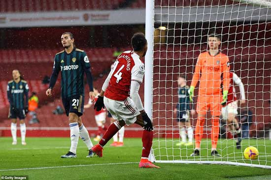 Arsenal skipper Aubameyang (14) seals his hat-trick after heading home unmarked at the back post on Sunday against Leeds United.