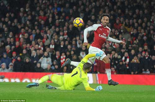 Pierre-Emerick Aubameyang is pictured chipping the onrushing Jordan Pickford to put Arsenal 4-0 ahead after just 37 minutes on Saturday