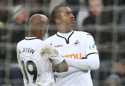 Swansea City's Ayew brothers celebrated in their own particular way after Jordan (right) scored from the spot.