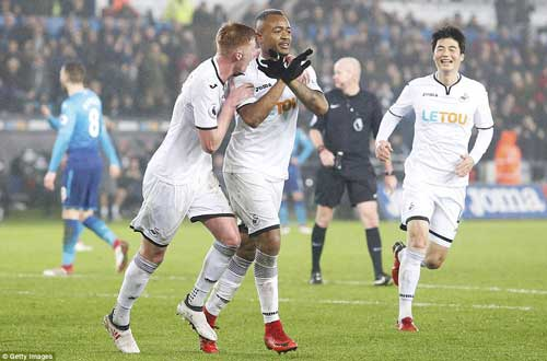 Jordan Ayew (centre) celebrates with his team-mates after scoring a crucial goal in his team's fight against relegation.