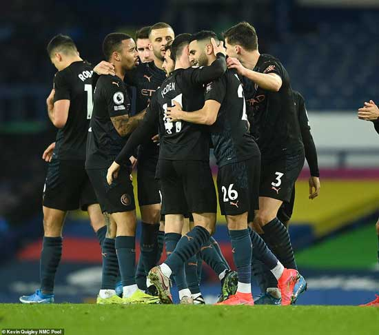 Mahrez is joined by his Manchester City team-mates after scoring a wonderful goal to put them ahead against Everton
