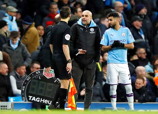 Manchester City manager Pep Guardiola prepares to substitute Riyad Mahrez in Etihad Stadium. Jason Cairnduff / Action Images via Reuters file