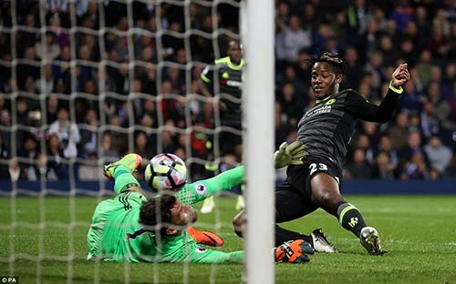 Late substitute Michy Batshuayi tucks the ball past Ben Foster to help Chelsea secure the Premier League title.