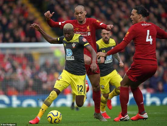 Liverpool centre back Virgil van Dijk (right) and midfielder Fabinho try to stop Southampton's Moussa Djenepo