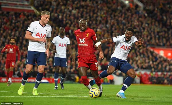A spot kick later converted by Mohammed Salah for the winner is awarded after after Serge Aurier kicked through into the back of the legs of Sadio Mane.