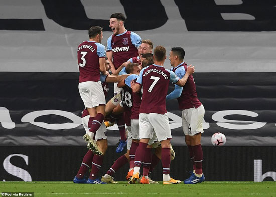 West Ham players bundled on top of each other in delirium with Lanzini's goal, the last kick of the clash, rescuing them a draw.