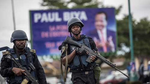 FILE - Members of the Cameroonian Gendarmerie patrol during a rally in support of Cameroonian President Paul Biya, Oct. 3, 2018.