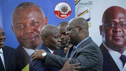Felix Tshisekedi (R) of Congo's Union for Democracy and Social Progress opposition party, hugs Vital Kamerhe (L) of Congo's Union for the Congolese Nation opposition party, after being endorsed Kamerhe at a press conference in Nairobi, Kenya, Nov. 23, 2018.
