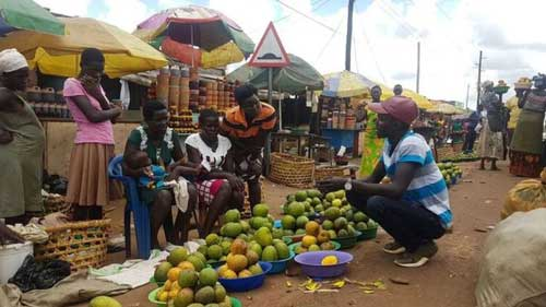 Lawrence often visits markets in Uganda, explaining his product to local sellers