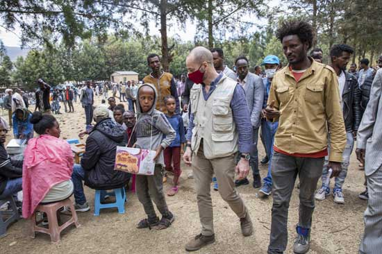 Manuel Fontaine, UNICEF Director of the Office of Emergency Programmes, center, visits internally-displaced people in Adigrat Town, in the Tigray region of northern Ethiopia Monday, Feb. 22, 2021. (Zerihun Sewunet/UNICEF via AP)