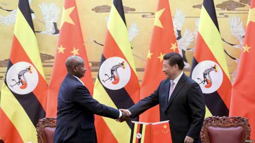 FILE - Ugandan President Yoweri Kaguta Museveni, left, shakes hands with Chinese President Xi Jinping during a signing ceremony in the Great Hall of the People in Beijing, March 31, 2015. VOA image