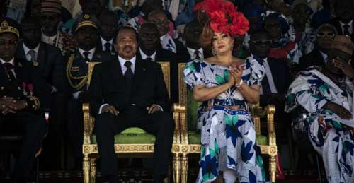 Cameroonian President Paul Biya and his wife, Chantal Biya, listen to speeches in honour of Biya's reign during an election rally at the Maroua Stadium, in the Far North Region of Cameroon, on September 29, 2018.