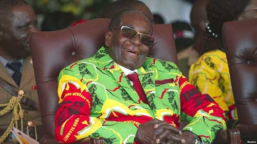 FILE - Zimbabwean President Robert Mugabe smiles during a youth rally in Marondera about 100 kilometers east of Harare.
