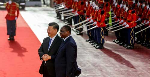 © This handout from the Senegalese Presidency taken and released on July 21, 2018 shows Senegal's President Macky Sall (R) shaking hands with China's President Xi Jinping as he arrives at the Palace of the Republic in Dakar.