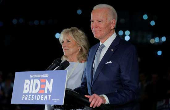 Democratic U.S. presidential candidate and former Vice President Joe Biden speaks with his wife Jill at his side during a primary night speech at The National Constitution Center in Philadelphia, Pennsylvania, U.S., March 10, 2020. Reuters phoot