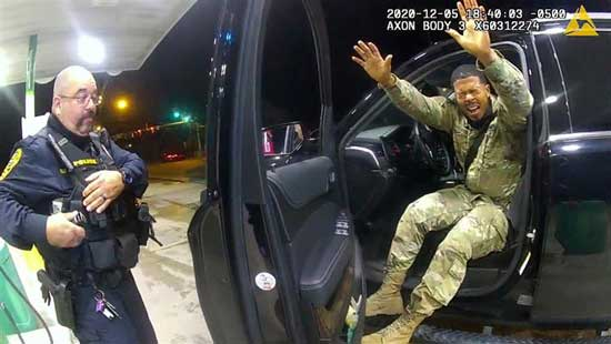 US Army 2nd Lieutenant Caron Nazario exits his vehicle after being sprayed with a chemical agent by Windsor police officer Joe Gutierrez (L) at a gas station during a violent traffic stop in a still image from officer Daniel Crockers body camera taken in Windsor, Virginia, US, on May 12, 2020. Windsor Police/Handout via Reuters