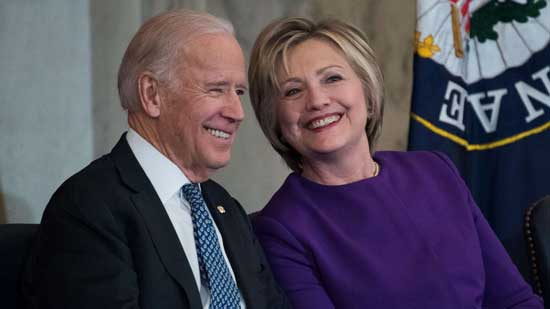 Former Vice President Joe Biden and former Secretary of State Hillary Clinton attend an event, De. 8, 2016 in Washington.