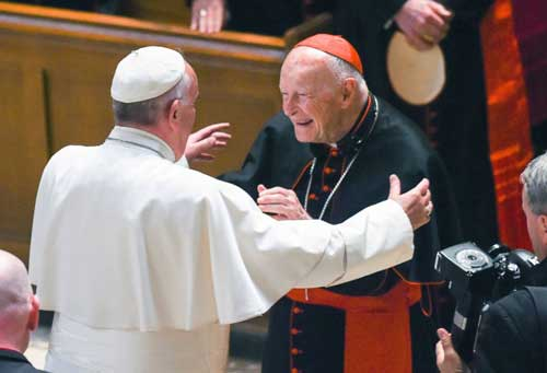 In this Sept. 23, 2015 file photo, Pope Francis reaches out to hug Cardinal Archbishop emeritus Theodore McCarrick after the Midday Prayer of the Divine with more than 300 U.S. Bishops at the Cathedral of St. Matthew the Apostle in Washington. AP photo