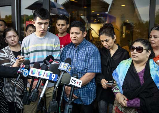 Surrounded by family members and supporters, Marlen Ochoa-Lopez's father, Arnulfo Ochoa, talks to reporters outside the Cook County medical examiner's office after identifying his daughter's body on May 16, 2019 in Chicago.Ashlee Rezin / Chicago Sun-Times via AP