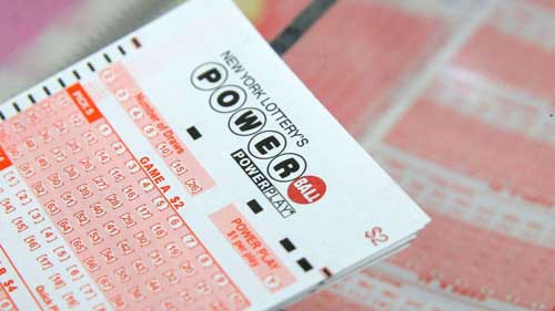 (Andrew Kelly/Reuters, FILE)  A ticket for the Powerball sits on a counter in a store in New York, Feb. 22, 2017.