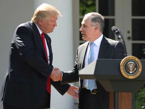 File - In this June 1, 2017 photo, President Donald Trump shakes hands with EPA Administrator Scott Pruitt after speaking about the Paris climate change accord in the Rose Garden in Washington.