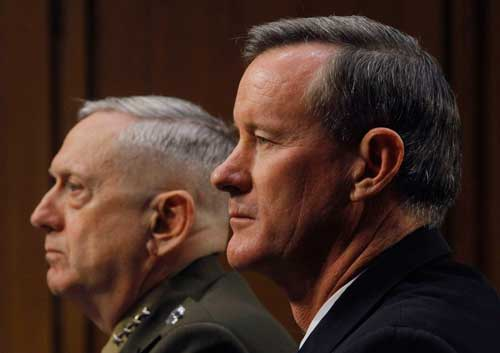 Navy Adm. William McRaven, right, and U.S. Marine Corps Gen. James Mattis in 2013. (Gary Cameron/Reuters)