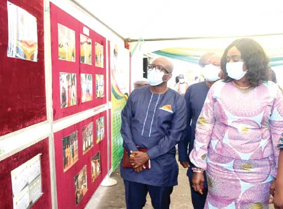 Mrs Barbara Oteng-Gyasi (right), the Minister of Tourism, Arts and Culture, being conducted round a photo exhibition mounted at the event. Picture: Patrick Dickson