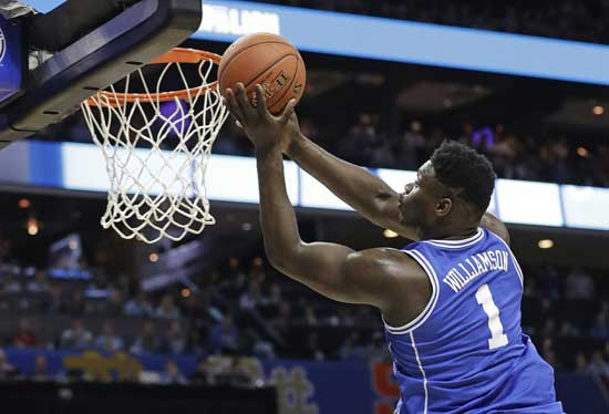 File - Duke's Zion Williamson (1) drives to the basket against North Carolina during the first half of an NCAA college basketball game in the Atlantic Coast Conference tournament in Charlotte, N.C., Friday, March 15, 2019. (AP Photo/Chuck Burton)