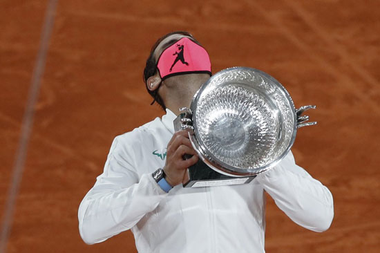 Spain's Rafael Nadal holds the trophy as he celebrates winning the final match of the French Open tennis tournament against Serbia's Novak Djokovic in three sets, 6-0, 6-2, 7-5, at the Roland Garros stadium in Paris, France, Sunday, Oct. 11, 2020. (AP Photo/Alessandra Tarantino)