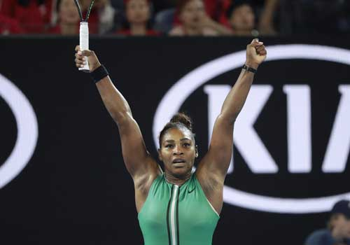 United States' Serena Williams celebrates after defeating Romania's Simona Halep in their fourth round match at the Australian Open tennis championships in Melbourne, Australia, Monday, Jan. 21, 2019. (AP Photo/Kin Cheung)