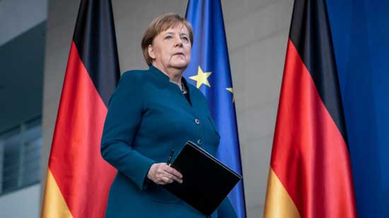 German Chancellor Angela Merkel arrives to make a press statement on the spread of the new coronavirus COVID-19 at the Chancellery, in Berlin on March 22, 2020. AFP photo