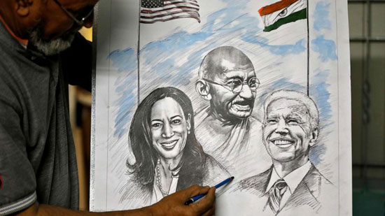 Aejaz Saiyad, an artist, gives finishing touches to a drawing of U.S. President-elect Joe Biden, Vice President-elect Kamala Harris and India's independence hero Mahatma Gandhi at his home in Ahmedabad, India, January 20, 2021.