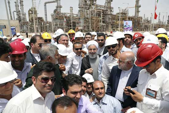 In this April 30, 2017 file photo, released by an official website of the office of the Iranian Presidency, Iranian President Hassan Rouhani, center, inaugurates the Persian Gulf Star Refinery in Bandar Abbas, Iran. Five Iranian tankers likely carrying at least $45.5 million worth of gasoline and similar products are now sailing to Venezuela as of Sunday, May 17, 2020, part of a wider deal between the two U.S.-sanctioned nations amid heightened tensions between Tehran and Washington. Analysts say the gasoline they carry came from the Persian Gulf Star Refinery. (Iranian Presidency Office via AP, File)