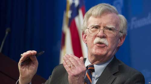 FILE - National Security Adviser John Bolton unveils the Trump Administration's Africa Strategy at the Heritage Foundation in Washington, Dec. 13, 2018.
