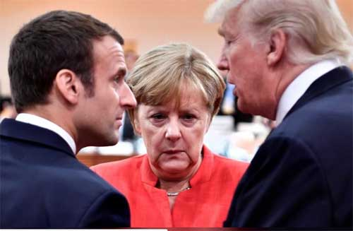 French President Emmanuel Macron, German Chancellor Angela Merkel and U.S. President Donald Trump confer at the start of the first working session of the G20 meeting in Hamburg, Germany, July 7, 2017. Reuters file image.