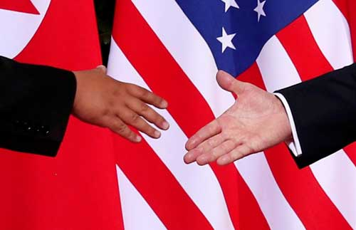 U.S. President Donald Trump shakes hands with North Korean leader Kim Jong Un at the Capella Hotel on Sentosa island in Singapore June 12, 2018. File image courtesy of Reuters/Jonathan Ernst