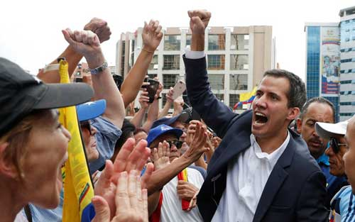 Buoyed by protesters and US, Maduro rival Guaido claims Venezuela presidency