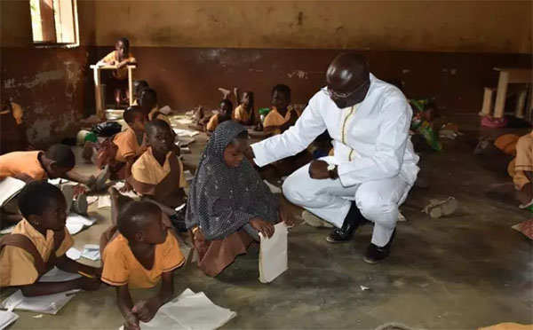 File image - Vice President Dr. Alhaji Bawumia at a school in the Wa East Constituency during his time in opposition with the NPP government. He later ordered and paid for furniture for the school out of his pocket