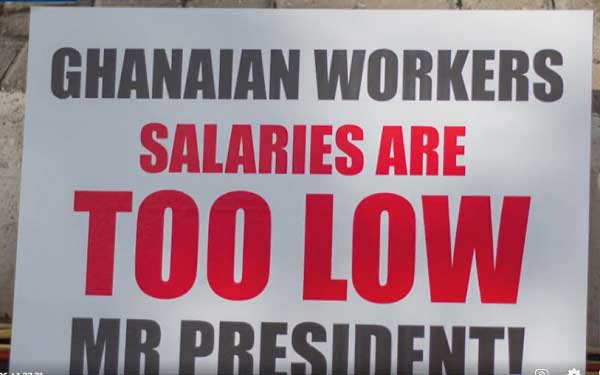 A placard being displayed at the forecourt of the TUC in Accra during the 2021 National May Day Celebration.
