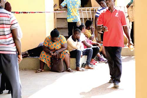 Anxious parents waiting at the Black Star Square to have their problem with school placement solved for their wards. Picture: EMMANUEL ASAMOAH ADDAI