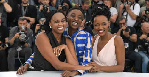 "© Loic Venance, AFP | Kenyan director Wanuri Kahiu (left) and actresses Samantha Mugatsia and Sheila Munyiva (right) pose at the Cannes Film Festival on May 9, 2018 during a photocall for the film ""Rafiki"""