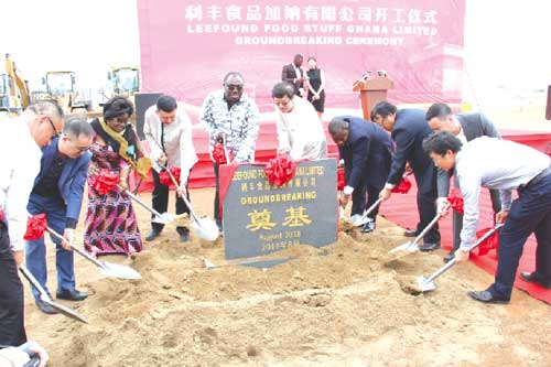 Mr Robert Ahomka-Lindsay (5th left) and Mr Zhang Jun (6th left) cutting the sod for the commerncement of work on the project. Those with them are Mrs Gifty Ohene-Konadu (3rd left) and Mr Tang Hong (8th left). Picture: BENEDICT OBUOBI