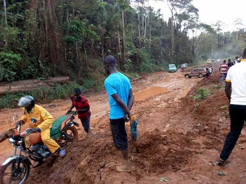 Residents and commuters slugging through the bad section of the road the links Juabeso district and Bia West in the Western Region of Ghana. Image credit - John Ennin Boadu