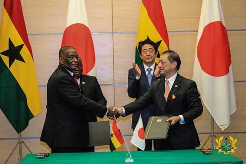 Ghana's Ambassador to Japan, Mr. Frank Okyere, and Japan's Ambassador to Ghana, Mr. Himeno, exchanging the notes after the signing the agreement for the receipt of $57 million