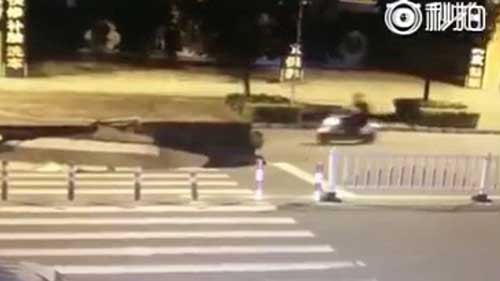 Motorcyclist plunges into sinkhole in China while fiddling with his phone