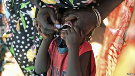 FILE - A displaced South Sudanese child receives an oral cholera vaccine in a camp for internally displaced people in the United Nations Mission in South Sudan compound in Tomping, Juba, Feb. 2014.