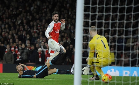 Olivier Giroud watches on excitedly as his powerful shot coasts through the legs of a helpless Joe Hart in the City goal to double Arsenal's lead.