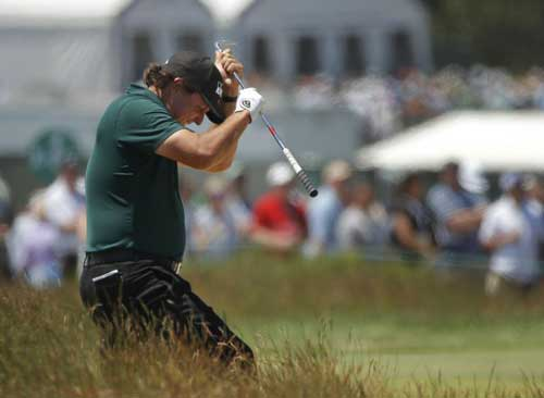 Phil Mickelson reacts to a shot from the fescue on the fifth hole during the third round of the U.S. Open. (AP)