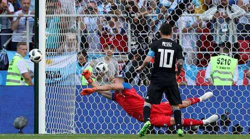 Iceland goalie Hannes Halldorsson saves Lionel Messi penalty kick..