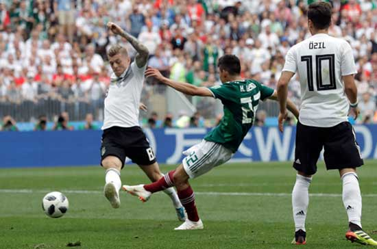 Mexico's Hirving Lozano, bangs in his side's opening goal from close range during the group F match between Germany and Mexico at the 2018 soccer World Cup.